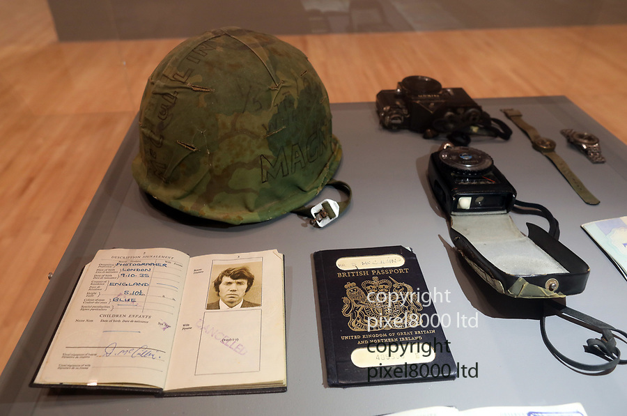Pic shows: Possession of Don McCullin on display including<br /> <br /> His passport and visa stamps from the Vietnam war.<br /> US Army helmet<br /> Nikon Camera body with bullet hole<br /> Light Meter<br /> Watches.<br /> <br /> <br /> Don McCullin - at the Tate Britain in London today where he has a major retrospective opening.<br /> <br /> He is a celebrated war photographer<br /> <br /> <br /> <br /> <br /> pic by Gavin Rodgers/Pixel8000