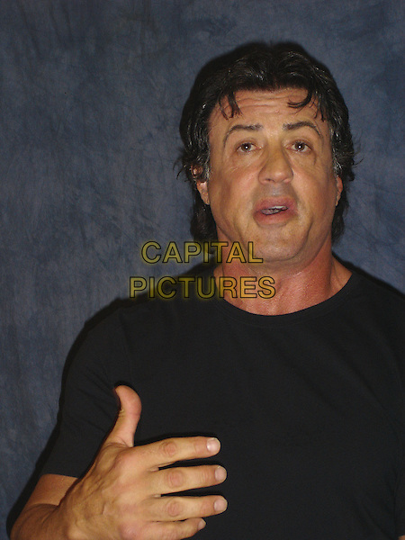 SYLVESTER STALLONE.Photocall in the Wetherly Room at The Four Seasons Hotel in Beverly Hills, USA..November 7th 2006.Ref: AW.headshot portrait hand.www.capitalpictures.com.sales@capitalpictures.com.©Anita Weber/Capital Pictures.