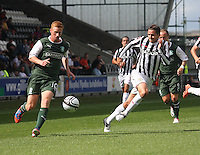 Eoin Doyle beating Lee Mair in the St Mirren v Hibernian Clydesdale Bank Scottish Premier League match played at St Mirren Park, Paisley on 18.8.12.