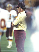 Washington Redskins head coach Joe Gibbs watches the action during the pre-season game against the Miami Dolphins at RFK Stadium in Washington, D.C. on August 25, 1989.  The Redskins won the game 35 - 21.<br /> Credit: Arnold Sachs / CNP