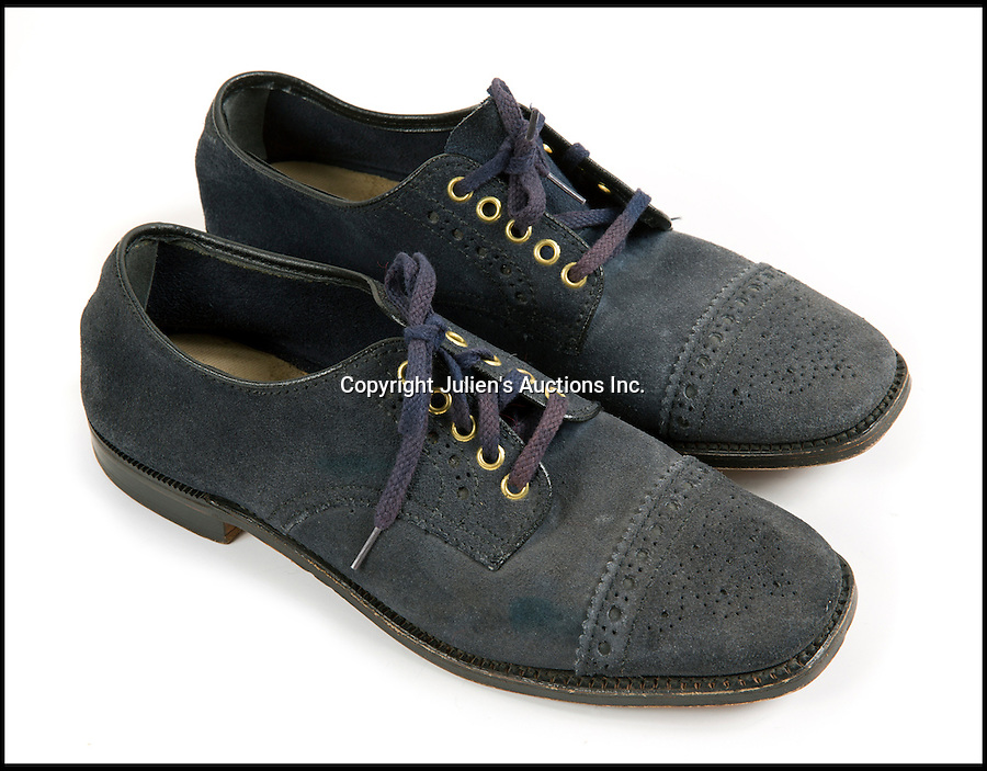 BNPS.co.uk (01202 558833)<br /> Picture: JuliensAuctions/BNPS<br /> <br /> ***Please use full byline***<br /> <br /> One for the money...<br /> <br /> The only known pair of Elvis Presley's blue suede shoes have emerged after more than 50 years. The size 10s were bought by The King after the success of the 1956 song of the same name. He wore them on stage so much that there is circular wear in the soles from Elvis' famous gyrating moves. The shoes are tipped to sell for &pound;50,000 at Julien's Auctions in LA.