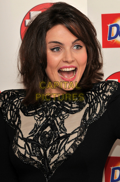 EMMER KENNY .Attending the TV Choice Awards 2010 at The Dorchester, London, England, UK, September 6th, 2010..arrivals portrait headshot mouth open funny  black shoulder pads cream patterned pattern beaded .CAP/PL.©Phil Loftus/Capital Pictures.