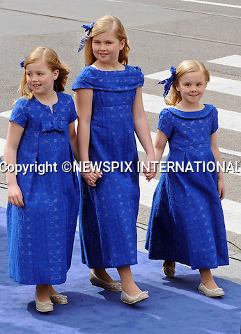 """30.04.2013; Amsterdam: KING WILLEM-ALEXANDER INAUGURATION.PRINCESS ALEXIA(left), PRINCESS CATHARINA-AMALIA AND PRINCESS ARIANE(right) OF THE NETHERLANDS.Princess Alexia (left) Crown Princess Catharina-Amalia, and Princess Ariane (right).attend their father King Willem-Alexander's inauguration at Nieuwe Kerk, Amsterdam, The Netherlands, .Mandatory Credit Photos: ©NEWSPIX INTERNATIONAL..**ALL FEES PAYABLE TO: """"NEWSPIX INTERNATIONAL""""**..PHOTO CREDIT MANDATORY!!: NEWSPIX INTERNATIONAL(Failure to credit will incur a surcharge of 100% of reproduction fees)..IMMEDIATE CONFIRMATION OF USAGE REQUIRED:.Newspix International, 31 Chinnery Hill, Bishop's Stortford, ENGLAND CM23 3PS.Tel:+441279 324672  ; Fax: +441279656877.Mobile:  0777568 1153.e-mail: info@newspixinternational.co.uk"""