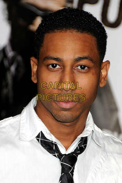 """BRANDON T. JACKSON .at Alcon Entertainment's L.A. Premiere of """"The Book of Eli"""" held at The Chinese Theatre in Hollywood, California, USA, .January 11th 2010. .portrait headshot white shirt black tie .CAP/ADM/BP.©Byron Purvis/AdMedia/Capital Pictures."""