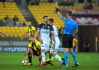 Kosta Barbarouses is yellow carded during the A-League football match between Wellington Phoenix and Melbourne Victory at Westpac Stadium in Wellington, New Zealand on Friday, 10 January 2018. Photo: Dave Lintott / lintottphoto.co.nz