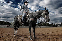 Rodeo champion Trevor Brazile, sits on his horse at his ranch near Decator, Texas, Monday, Octoer 30, 2006. Brazile has won three world rodeo titles, and in 2006 became the youngest in the Professional Rodeo Cowboys Association and the seventh overall to cross the $2 million mark in career earnings.