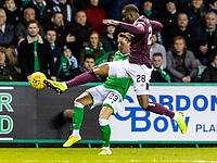3rd March 2020; Easter Road, Edinburgh, Scotland; Scottish Premiership Football, Hibernian versus Heart of Midlothian; Clevid Dikamona of Hearts clears from Scott Allan of Hibernian