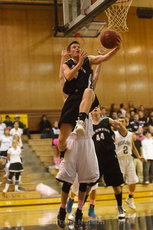 Trent Nelson  |  The Salt Lake Tribune.Riverton's Stephan Holm drives for a layup at Highland vs. Riverton High School basketball in Salt Lake City, Utah, Friday, December 2, 2011.