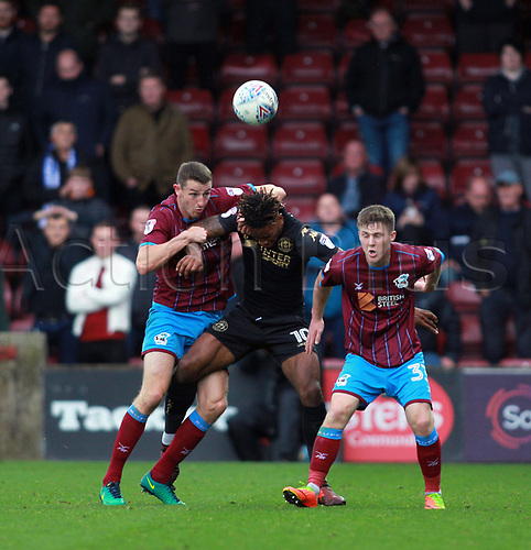 7th October 2017, Glanford Park, Scunthorpe, England; EFL League One football, Scunthorpe versus Wigan; Ivan Toney of Wigan Athletic battles for the bal with ex-team mate Rory McArdle of Scunthorpe United and Lewis Butroid of Scunthorpe United in the 1-2 win for Wigan