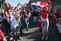 Panamanian fans cheer against USA fans marching from Occidental Park to Century Link Field before the USA Men's National Team's World Cup Qualifier against Panama in Seattle, WA on June 11, 2013.