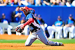 7 March 2010: Washington Nationals' infielder Alberto Gonzalez makes a play from his knees during a Spring Training game against the New York Mets at Tradition Field in Port St. Lucie, Florida. The Mets edged out the Nationals 6-5 in Grapefruit League pre-season play. Mandatory Credit: Ed Wolfstein Photo