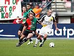 Nederland, Nijmegen, 2 december 2012.Eredivisie .Seizoen 2012-2013.N.E.C.-NAC Breda.Anthony Lurling (l.) van NAC Breda en Michel Breuer (r.) van N.E.C. strijden om de bal.