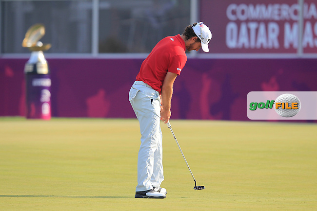 Alejandro Canizares (ESP) putts on the 18th green during Saturday's Final Round of the Commercial Bank Qatar Masters 2014 held at Doha Golf Club, Doha, Qatar. 25th January 2014.<br /> Picture: Eoin Clarke www.golffile.ie