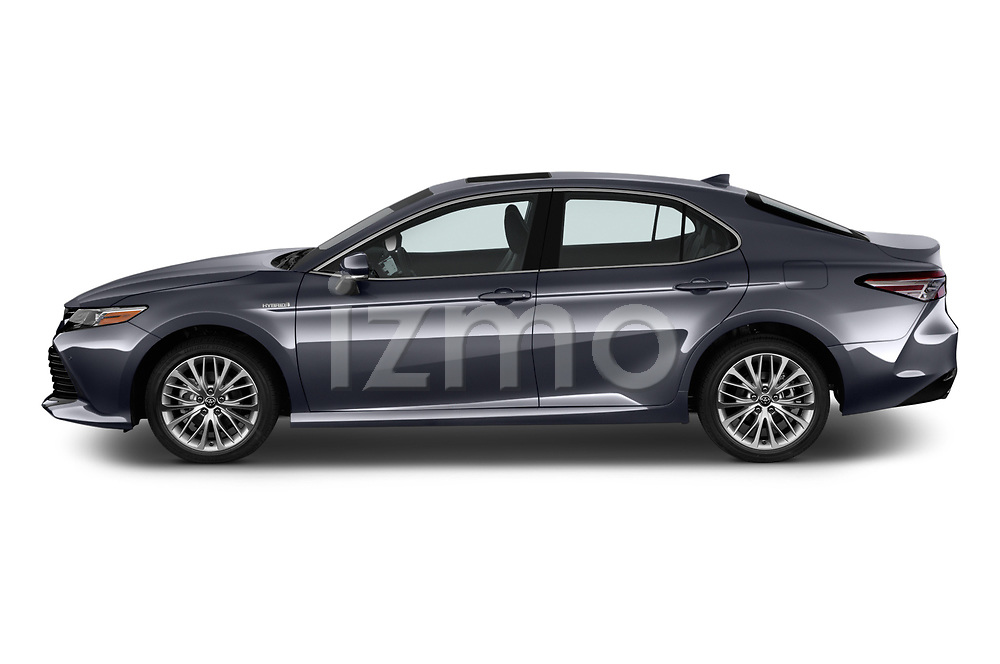 Car driver side profile view of a 2019 Toyota Camry XLE Hybrid 4 Door Sedan