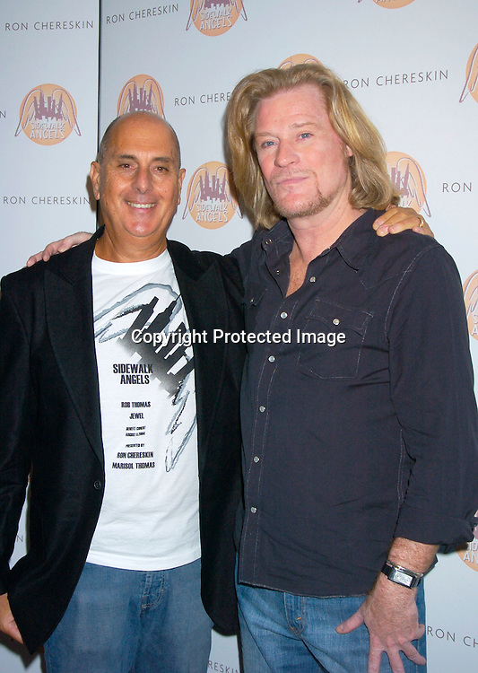 Ron Chereskin and Daryl Hall ..at the benefit for Sidewalk Angels Foundation on August 3, 2004 at The China Club. ..Photo by Robin Platzer, Twin Images..