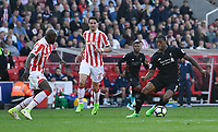 Liverpool's Georginio Wijnaldum under pressure from Stoke City's Bruno Martins Indi<br /> <br /> Photographer Terry Donnelly/CameraSport<br /> <br /> The Premier League - Stoke City v Liverpool - Saturday 8th April 2017 - bet365 Stadium - Stoke-on-Trent<br /> <br /> World Copyright &copy; 2017 CameraSport. All rights reserved. 43 Linden Ave. Countesthorpe. Leicester. England. LE8 5PG - Tel: +44 (0) 116 277 4147 - admin@camerasport.com - www.camerasport.com