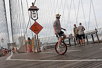 Brooklyn, NY -  3 September 2010 - Unicyclists cross the Brooklyn Bridge enroute to Coney Island during the 13 mile Brooklyn Long Distance Unicycle Ride.