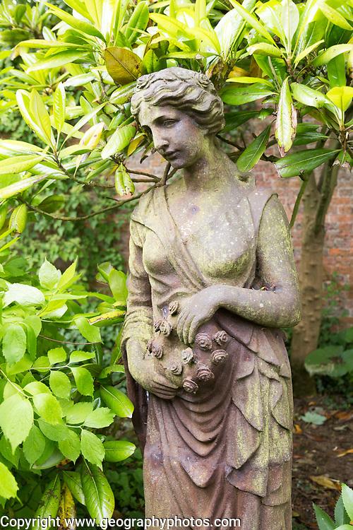 Classical style female cast iron statue figure statue, The Walled garden plant nursery, Benhall, Suffolk, England, UK