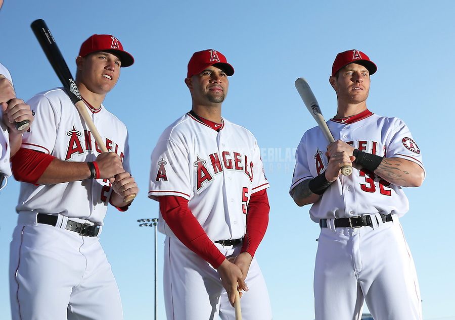Feb. 21, 2113; Tempe, AZ, USA: Los Angeles Angels outfielder Mike Trout (left), first baseman Albert Pujols (center) and outfielder Josh Hamilton pose for a portrait during photo day at Tempe Diablo Stadium. Mandatory Credit: Mark J. Rebilas-