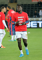 "Bafetimbi Gomis of Swansea warms up wearing a ""Show Racism the Red Card"" shirt before the Barclays Premier League match between Swansea City and Stoke City played at the Liberty Stadium, Swansea on October 19th 2015"