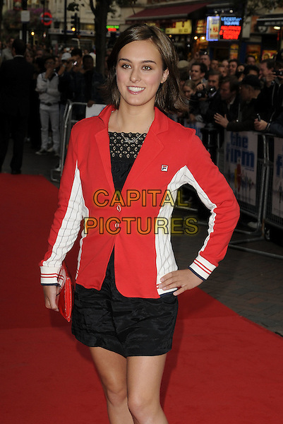 "LOUI BATLEY.""The Firm"" UK Premiere, Vue West End cinema, Leicester Square, London, England..September 10th, 2009.half 3/4 length black red white jacket dress skirt hand on hip clutch bag.CAP/CAN.©Can Nguyen/Capital Pictures."
