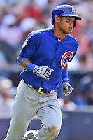 Chicago Cubs shortstop Addison Russell (27) runs to first during a game against the Atlanta Braves at Turner Field on June 11, 2016 in Atlanta, Georgia. The Cubs defeated the Braves 8-2. (Tony Farlow/Four Seam Images)