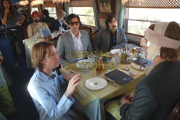 WES ANDERSON (DIRECTOR), OWEN WILSON, ADRIEN BRODY & JASON SCHWARTZMAN .on the set of The Darjeeling Limited .*Filmstill - Editorial Use Only*.CAP/FB.Supplied by Capital Pictures.