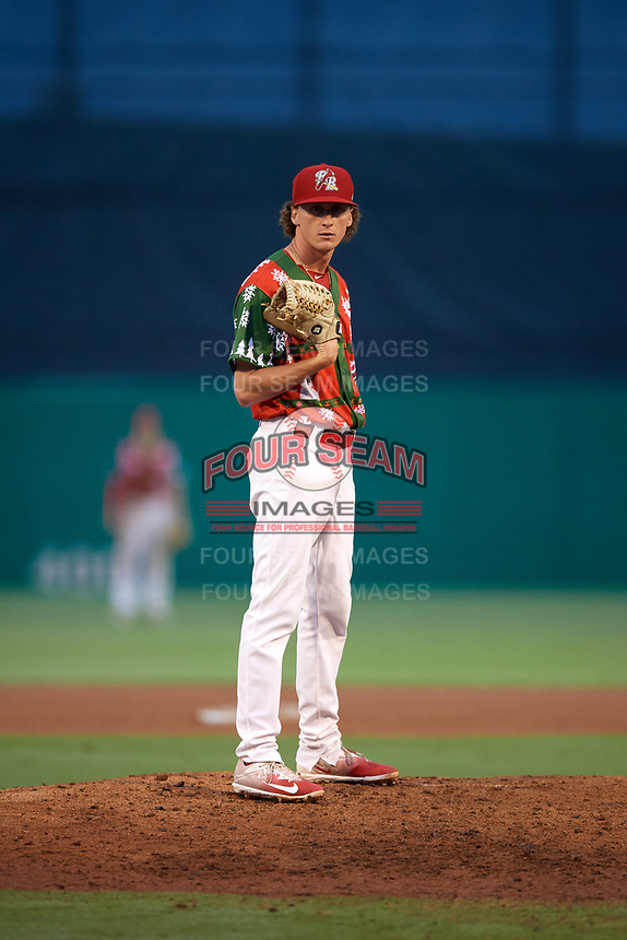 """Palm Beach Cardinals relief pitcher Brady Bowen (29) looks in for the sign during a game against the Charlotte Stone Crabs on July 22, 2017 at Roger Dean Stadium in Palm Beach, Florida.  The Cardinals wore special """"Ugly Sweater"""" jerseys for Christmas in July.  Charlotte defeated Palm Beach 5-2.  (Mike Janes/Four Seam Images)"""