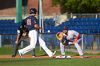 Reading Fightin Phils first baseman Christian Marrero (21) waits for a throw as Ryan Court (24) gets back to the bag during a game against the Portland Sea Dogs on May 31, 2016 at Hadlock Field in Portland, Maine.  Reading defeated Portland 6-4.  (Mike Janes/Four Seam Images)