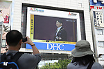 People watch a large screen showing Japan's new Emperor Naruhito attends the enthronement ceremony (Imperial regalia inheritance) in Tokyo, Japan on May 1, 2019, the first day of the Reiwa Era. (Photo by YUTAKA/AFLO)