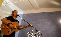 Colter Harper performs during an event at Barking Dog Studios in the South Side of Pittsburgh, Pennsylvania on February 4, 2012.
