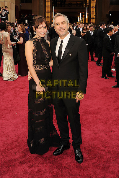 HOLLYWOOD, CA- MARCH 02: Director Alfonso Cuaron (R) and Sheherazade Goldsmith the 86th Annual Academy Awards held at Hollywood &amp; Highland Center on March 2, 2014 in Hollywood, California.<br /> CAP/ROT/TM<br /> &copy;Tony Michaels/Roth Stock/Capital Pictures