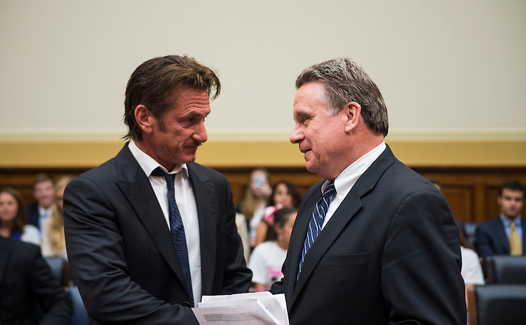 "UNITED STATES - MAY 20: Rep. Chris Smith, R-N.J., right, escorts actor Sean Penn, founder and CEO of the J/P Haitian Relief Organization, to the witness table for the House Foreign Affairs Committee TopicAfrica, Global Health, Global Human Rights and International Organizations Subcommittee hearing on ""Advocating for American Jacob Ostreicher's Freedom after Two Years in Bolivian Detention"" on Monday, May 20, 2013. (Photo by Bill Clark/CQ Roll Call)"