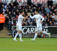 SWANSEA, WALES - FEBRUARY 21: Ki Sung Yueng of Swansea celebrates (R) his equaliser with team mate Jack Cork (L) during the Barclays Premier League match between Swansea City and Manchester United at Liberty Stadium on February 21, 2015 in Swansea, Wales.