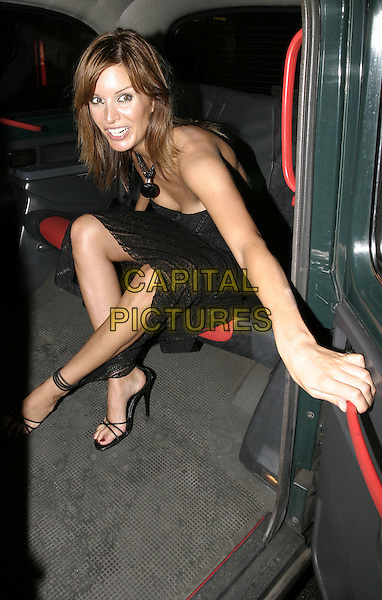 "CATALINA GUIRADO.UK Premiere of ""The Chronicles of Riddick: Pitch Black 2"", Vue Cinema, London,.9th August 2004..strapless black dress in car.Ref: AH.www.capitalpictures.com.sales@capitalpictures.com.©Capital Pictures."