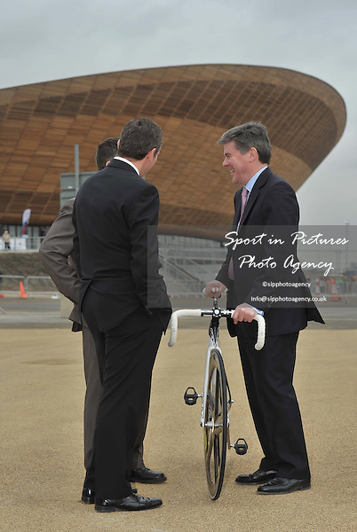 Hugh Robertson (Minister for Sport and the Olympics, right) talks to George Redmond (Chair Glasgow Life), Mike Amesbury (Executive Member for Culture and Leisure Manchester City Council),Track World Cup. London 2012 Olympic Velodrome. Stratford. London.. 17/02/2012. MANDATORY Credit Garry Bowden/Sportinpictures - NO UNAUTHORISED USE - 07837 394578