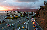Cars on the California Incline heading dwon onto the Pacific Coast HIghway in Santa Monica at Sunset.