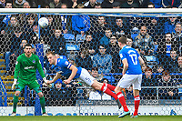 Matthew Clarke of Portsmouth (5) clears his lines with a header during Portsmouth vs Gillingham, Sky Bet EFL League 1 Football at Fratton Park on 10th March 2018