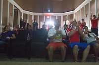 Denver, CO - Wednesday, June 18, 2014:  Chile fans cheer on their team playing Spain in a World Cup first round match in Thornton, CO.  They were among two dozen Chileans who gathered to watch the match at a private screening room in a condominium complex in suburban Denver.