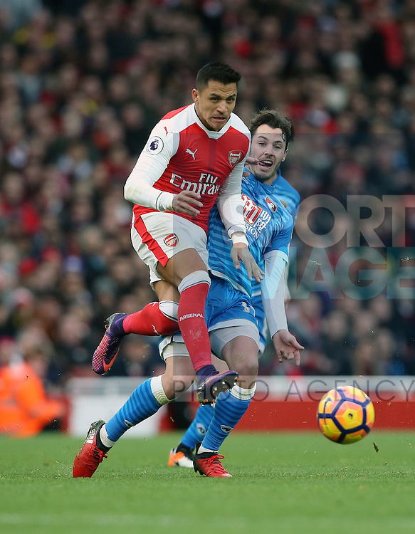Arsenal's Alexis Sanchez tussles with Bournemouth's Adam Smith during the Premier League match at the Emirates Stadium, London. Picture date October 26th, 2016 Pic David Klein/Sportimage
