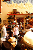 USA, California, San Francisco, trying on hats at Goorin Brothers Hat Shop in North Beach