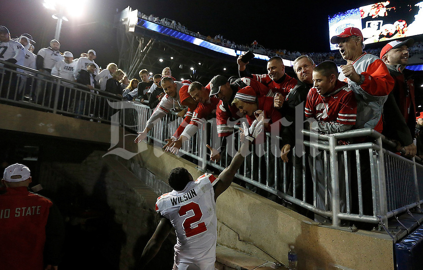 Ohio State Buckeyes running back Dontre Wilson (2) celebrates with fans after winning in the second overtime of the NCAA Division I football game at Beaver Stadium in University Park, PA on October 25, 2014. (Columbus Dispatch photo by Jonathan Quilter)