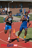 Ladue freshman Hasani Barr (left) passes a Riverview Gardens runner on the way to victory in the 4x400 at the 2016 MSHSAA Class 4 District 3 Track and Field Meet at Ladue High School, St. Louis, Saturday, May 14.