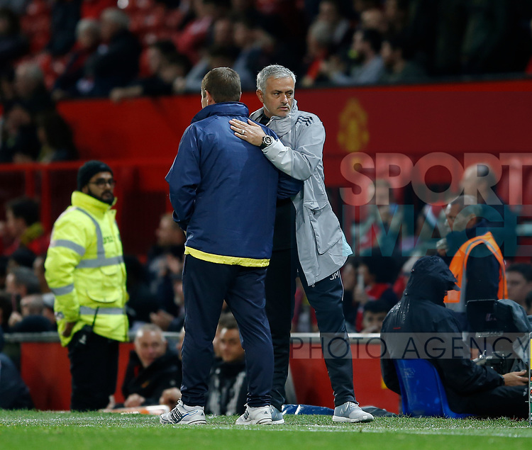 Jose Mourinho manager of Manchester United consoles Nigel Clough manager of Burton Albion during the Carabao Cup Third Round match at the Old Trafford Stadium, Manchester. Picture date 20th September 2017. Picture credit should read: Simon Bellis/Sportimage