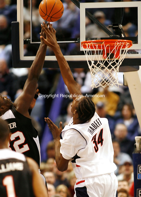HARTFORD, CT, 02/25/07- 022507BZ06- UConn's Hasheem Thabeet (34) tries to block Louisville's (32) Derrick Caracter <br />  during their game at the Hartford Civic Center Sunday afternoon.<br /> Jamison C. Bazinet Republican-American