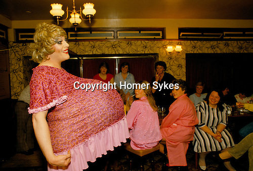'HEN PARTY', DRAG ARTIST FROM THE HARLEQUEENS, DRESSED AS A PREGNANT WOMAN WITH LARGE BUMP, PERFORMING AT THE DUKE OF CAMBRIDGE PUB IN SOUTH LONDON
