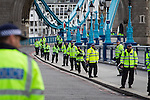© Joel Goodman - 07973 332324 . 07/09/2013 . London , UK . Police on Tower Bridge along the route of the EDL march . The EDL hold a march and demonstration in London today (Saturday 7th September 2013) . Photo credit : Joel Goodman