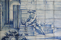 The chicken that laid golden eggs, from the fables of La Fontaine, traditional blue and white azulejos tile scene, 18th century, in the cloister of the Monastery of Sao Vicente de Fora, an Augustinian order monastery and church built in the 17th century in Mannerist style, Lisbon, Portugal. The monastery also contains the royal pantheon of the Braganza monarchs of Portugal. Picture by Manuel Cohen