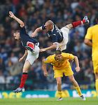 James McFadden and Steven Fletcher take a tumble over Veliche Shumuilkoski