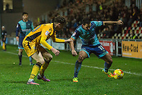 Sam Wood of Wycombe Wanderers takes on Tom Owen-Evans of Newport County during the Sky Bet League 2 match between Newport County and Wycombe Wanderers at Rodney Parade, Newport, Wales on 22 November 2016. Photo by Mark  Hawkins.